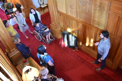 Image of Government House Visitor Centre Educator Owen Mann leading a house tour