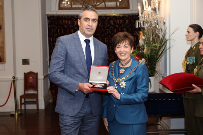 Image of Keving Ransfield accepting the insignia for the late Isobel Ransfield, of Otaki, QSM, for services to Māori