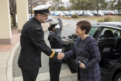 Image of Dame Patsy being greeted at the Australian Defence College by Acting Commander  Commodore Peter Leavy