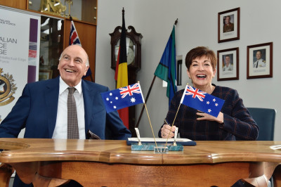 Image of Dame Patsy and Sir David signing the Visitor Book at the Australian Defence College