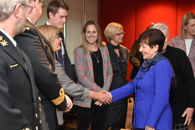 Image of Dame Patsy meeting staff at the New Zealand High Commission