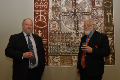 Two guests standing in front of an artwork
