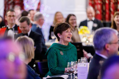 Dame Patsy Reddy at a table
