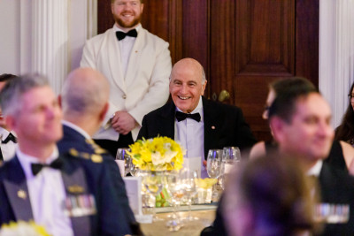 Sir David Gascoigne with guests at a table