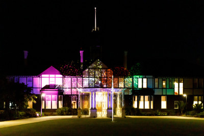 Government House lit up with a projection of fireworks