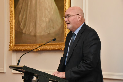 Colin Hardgrave speaking at a lectern