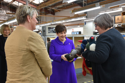 Fiona Pearson shows Dame Patsy Reddy some wool birds