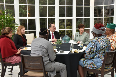 Dame Patsy sits at a table with new Ambassadors and High Commissioners