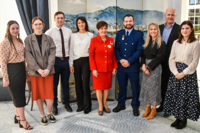 Dame Patsy Reddy with Constable Scott Higby and his family