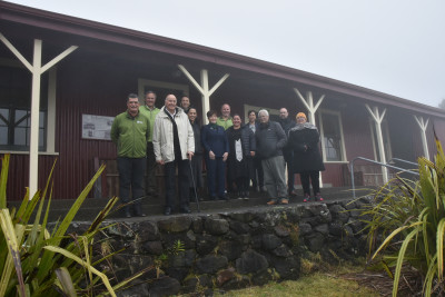 A group photo in front of the Camp House