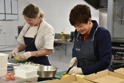 Dame Patsy Reddy and Michelle Hartley making salsa