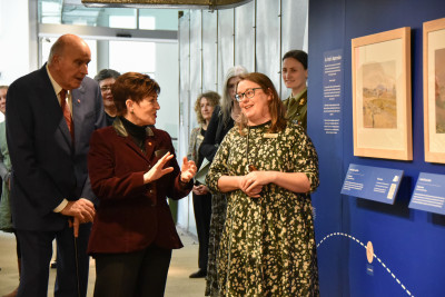 Dame Patsy Reddy looking at the Christopher Aubrey exhibition