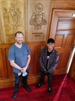 Chris Bath and Nathaniel Castro by the Coat of Arms