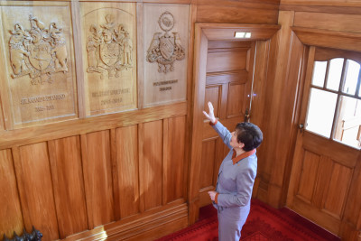 Dame Patsy speaking about the elements of her Coat of Arms