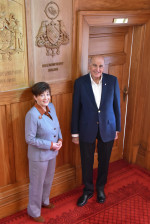 Dame Patsy Reddy and Sir David Gascoigne with the Coat of Arms
