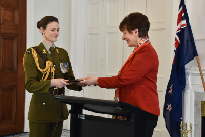 Aide de Camp handing letters of credence to Dame Patsy