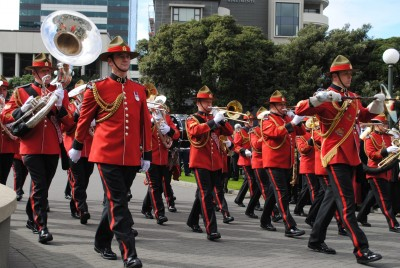 The New Zealand Army Band march onto the forecourt.
