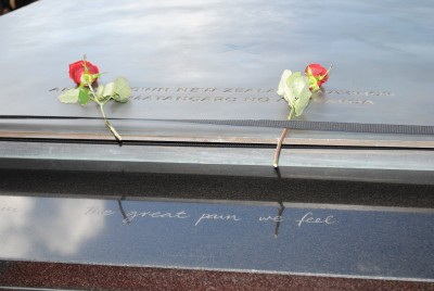 Sir Jerry and Lady Janine Mateparae each place a rose on the Tomb of the Unknown Warrior.